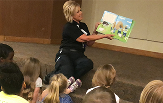 LifeNet reads a book to kids at the Texarkana Public Library