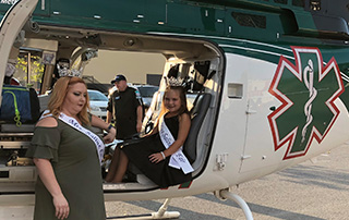 Little Miss Saline County sits inside the LifeNet Air medical helicopter at the Safety Expo in Benton in September 2018.