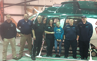 LifeNet air medical helicopter ambulance crew meets patient they saved at LNA hangar in Hot Springs.