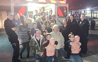 Fountain Lake Cobra Cub Scouts stand in front of a LifeNet Ambulance for a group photo.