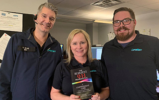 LifeNet EMS dispatchers hold a copy of the Resilient 9-1-1 Professional book.