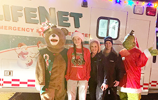 LifeNet staff stand outside a decorated ambulance for the Texarkana Christmas parade.