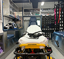 Inside of a LifeNet ambulance with equipment and stryker powerload cot.