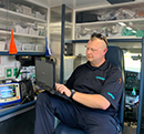 LifeNet Paramedic works on a tablet in the back of an ambulance in Malvern, Arkansas.