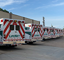 A row of LifeNet ambulances sits parked infront of headquarters in Texarkana, Texas.